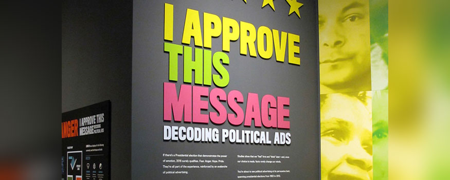 In this July 28, 2016 photo, a sign explains an exhibit on political campaign ads at the Toledo Museum in Toledo, Ohio. Photo: Associated Press